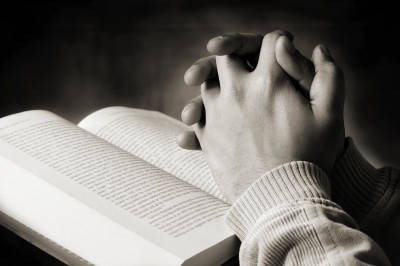 bible-with-praying-hands.jpg
