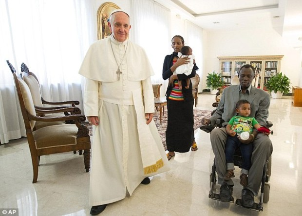 Ms Ibrahim and her husband, Daniel Wani, right, walk through the Vatican with the Pope