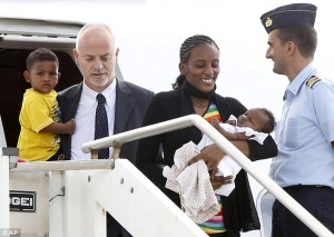Christian woman Meriam Ibrahim from Sudan holding her daughter Maya, along with Martin, accompanied by Italian deputy Foreign Minister Lapo Pistelli, after landing Ciampino's military airport, on the outskirts of Rome