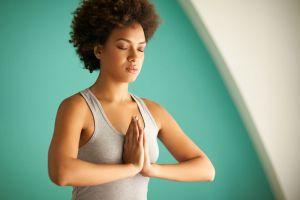 woman in prayer-meditating position