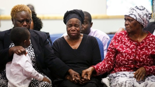Garteh Korkoryah, center, mother of 42 year old Thomas Eric Duncan, being comforted Saturday, October 18, Salisbury, NC, during a memorial service for her 42 year old son who died October 8, in a Dallas hospital.