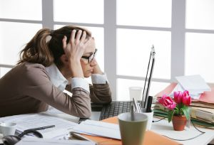 A young business woman stressed out at work (photo: shutterstock.com)