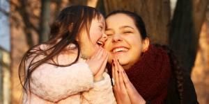 mother teaching daughter to pray