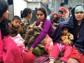 People take refuge at a school in Kathmandu after the Nepal earthquake (Reuters: Navesh Chitraker)