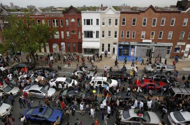 Demonstrators took to the streets in Baltimore, May 1st, 2015 same place where rioters clashed with police earlier in the week (photo: Reuters/Lucas Jackson)